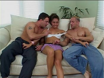 Beautiful girl sucks two peckers in threesome party