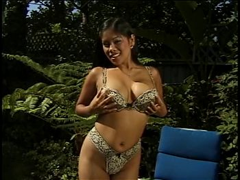 Busty Asian shows her assets and squirts wee outdoors